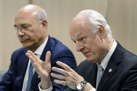 U.N. mediator on Syria Staffan de Mistura (R) gestures next to his Deputy Ramzy Ezzeldin Ramzy during a meeting with the Syrian government delegation during Syria peace talks at the United Nations in Geneva, Switzerland, April 15, 2016. REUTERS/Fabrice Coffrini/Pool