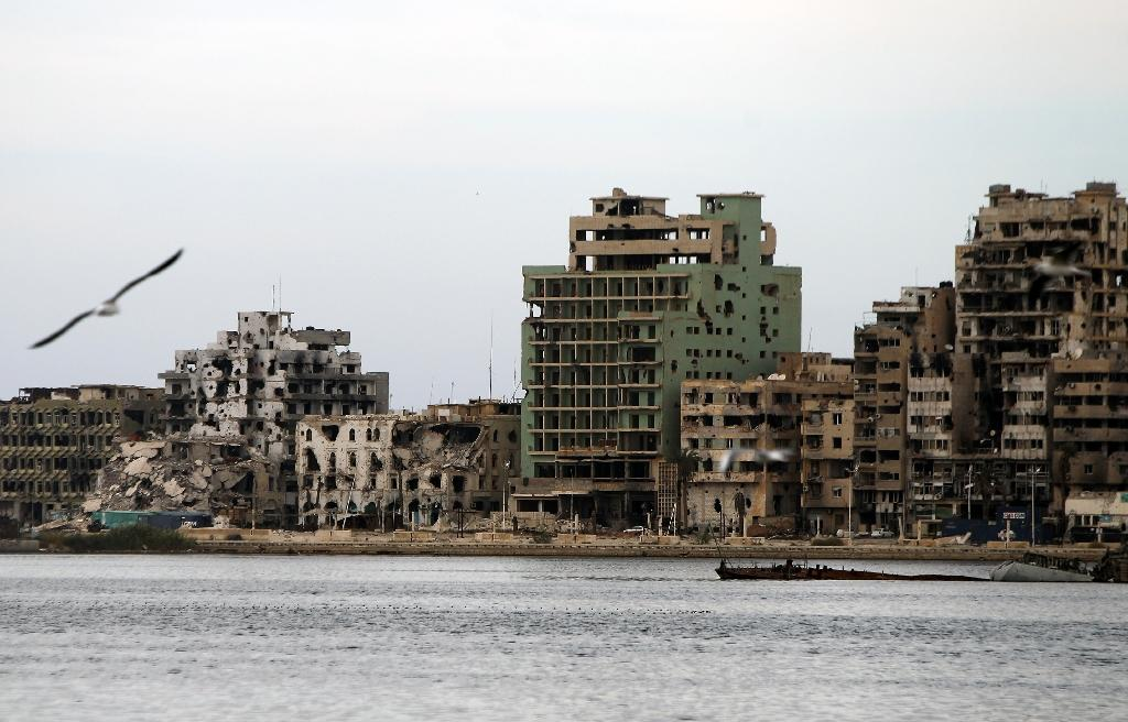Destroyed buildings in Libya's eastern coastal city of Benghazi are shown in October 2015 after clashes between soldiers of Libya's recognised government and anti-government forces, including Islamic State (IS) group (AFP Photo/Abdullah Doma)