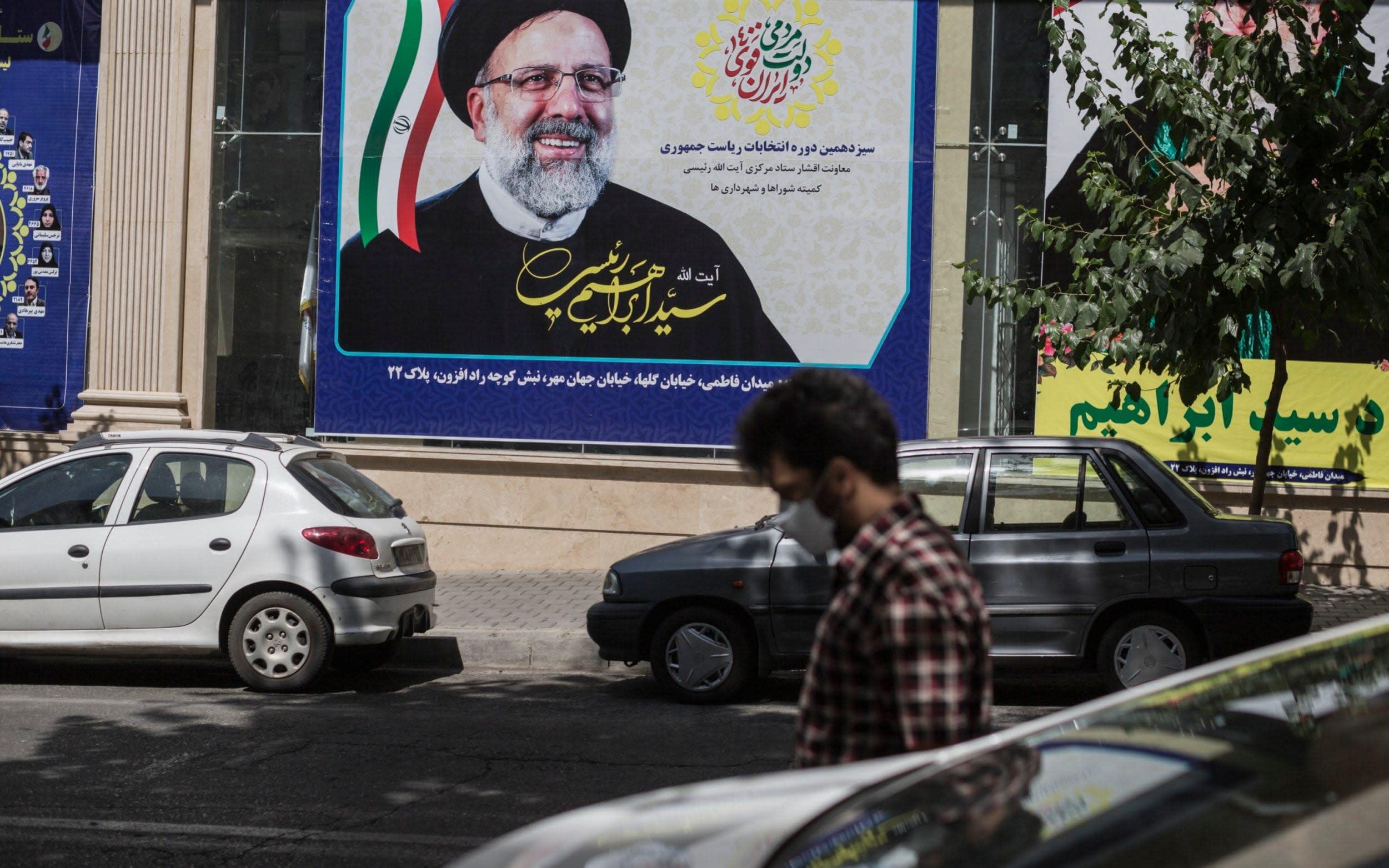 Hardline judge wins landslide victory in Iran election