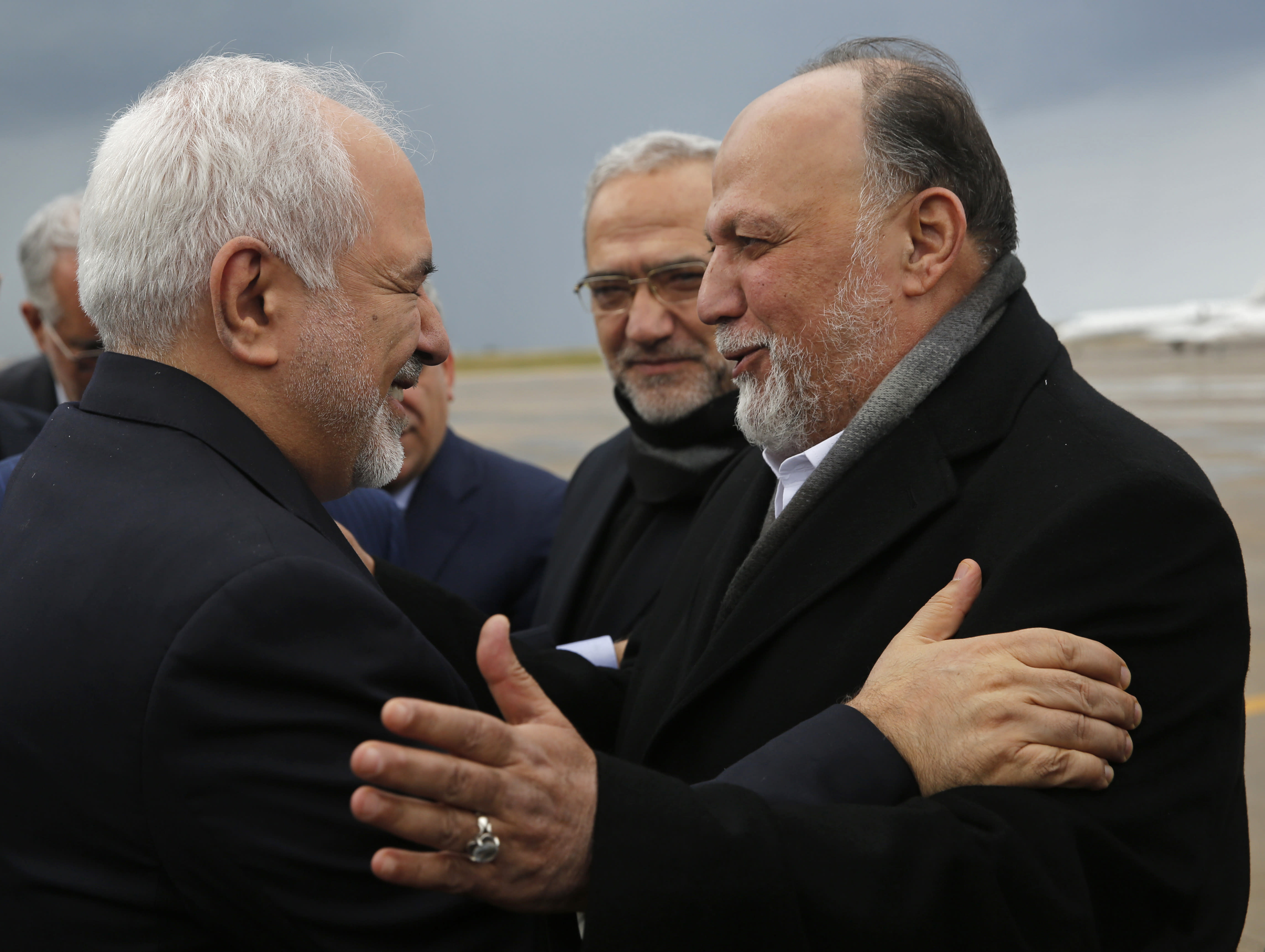 Iran's Foreign Minister Mohammad Javad Zarif, left, greets by Lebanese Hezbollah lawmaker, Ali Ammar, upon his arrival at Rafik Hariri Airport, in Beirut, Lebanon, Sunday, Feb. 10, 2019. Zarif said his country is ready to cooperate with the new Lebanese government, offering his country's support in all sectors. (AP Photo/Hussein Malla)