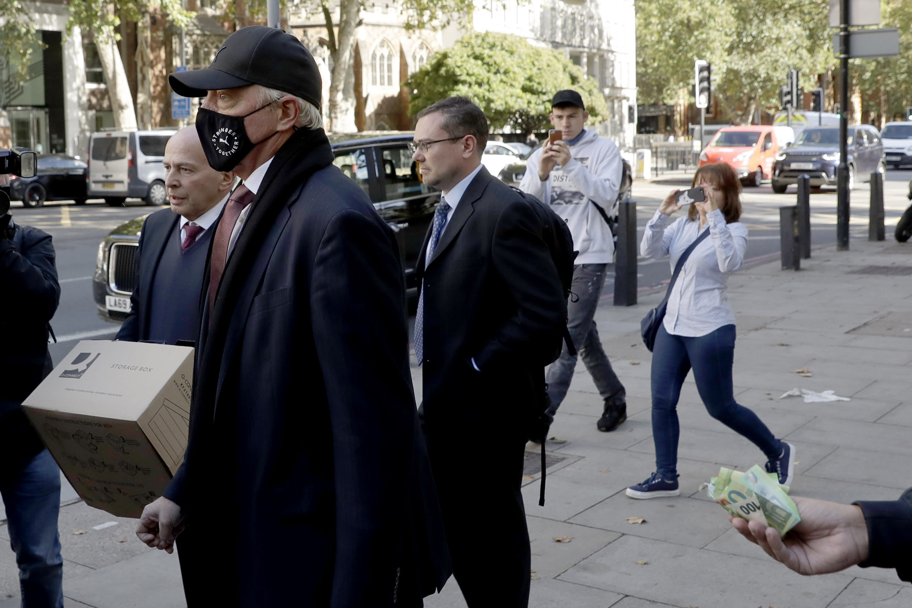 Retired German tennis star Boris Becker leaves Westminster Magistrates Court in London, after being declared bankrupt and accused of not complying with obligations to disclose information, Thursday, Sept. 24, 2020. Becker is being prosecuted by the Insolvency Service. (AP Photo/Matt Dunham)