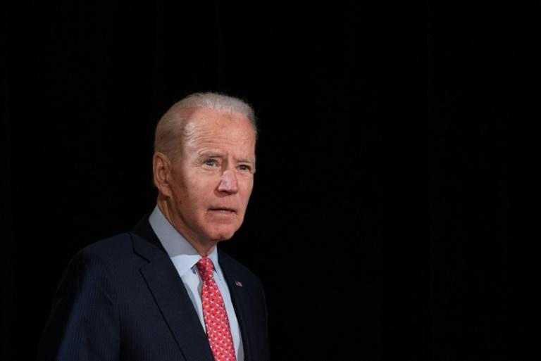 Former US vice president and Democratic presidential hopeful Joe Biden arrives to speak about COVID-19 on March 12 (AFP Photo/SAUL LOEB)