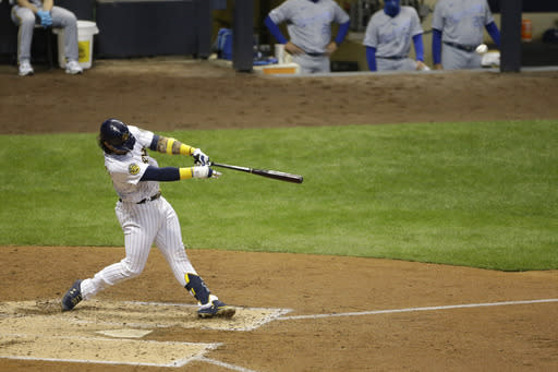 Milwaukee Brewers' Jacob Nottingham hits a grand slam during the fourth inning of a baseball game against the Kansas City Royals, Friday, Sept. 18, 2020, in Milwaukee. (AP Photo/Aaron Gash)