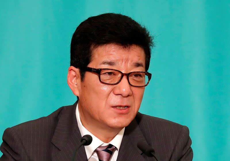 Japan mayor under fire for 'women dawdle at shops' remark