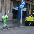 Spain's coronavirus deaths tick up again to near 14,000