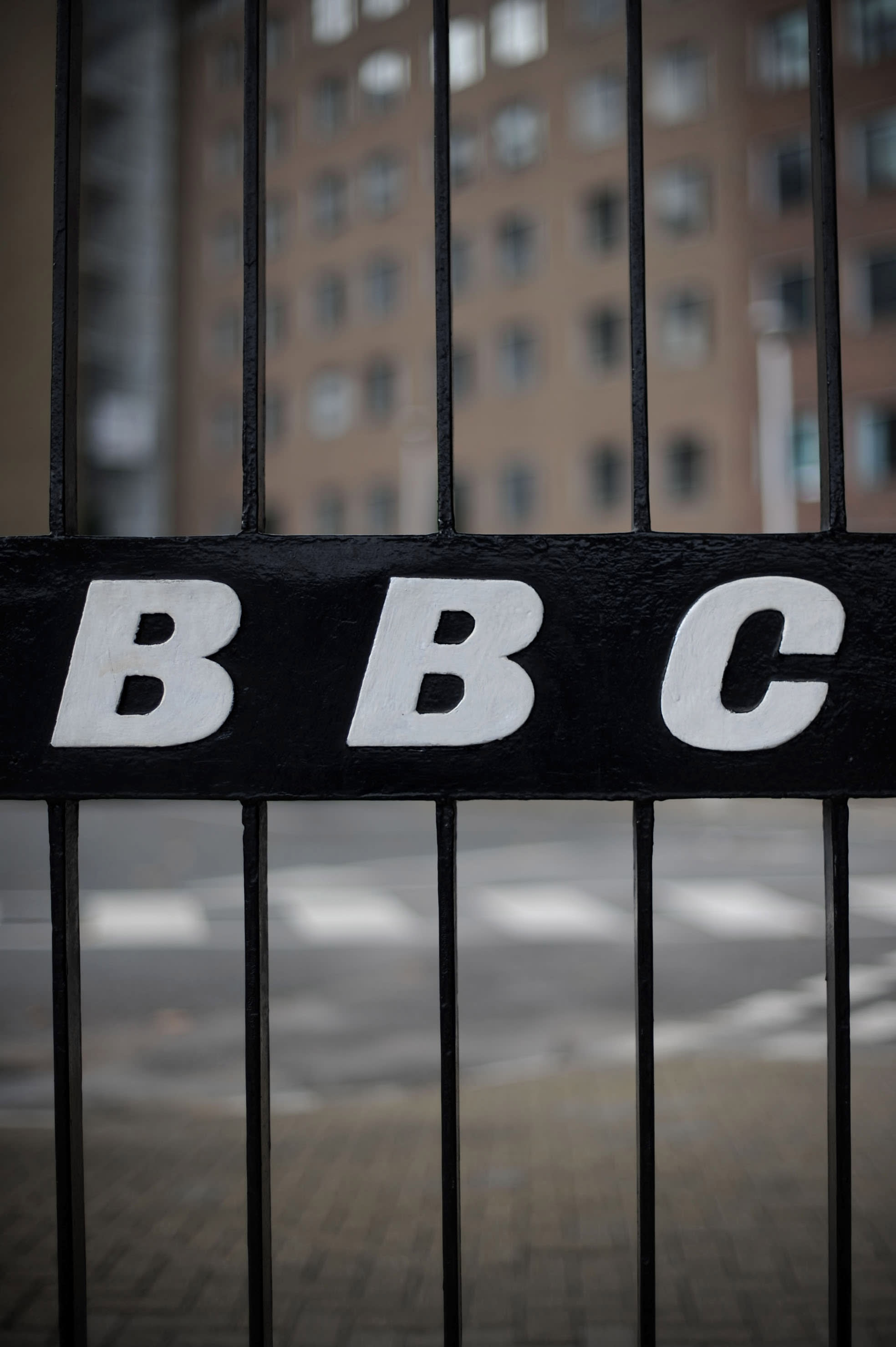 A view of a BBC logo on a gate near the entrance to the BBC Television offices in west London, on October 6, 2011 (AFP Photo/Carl Court)