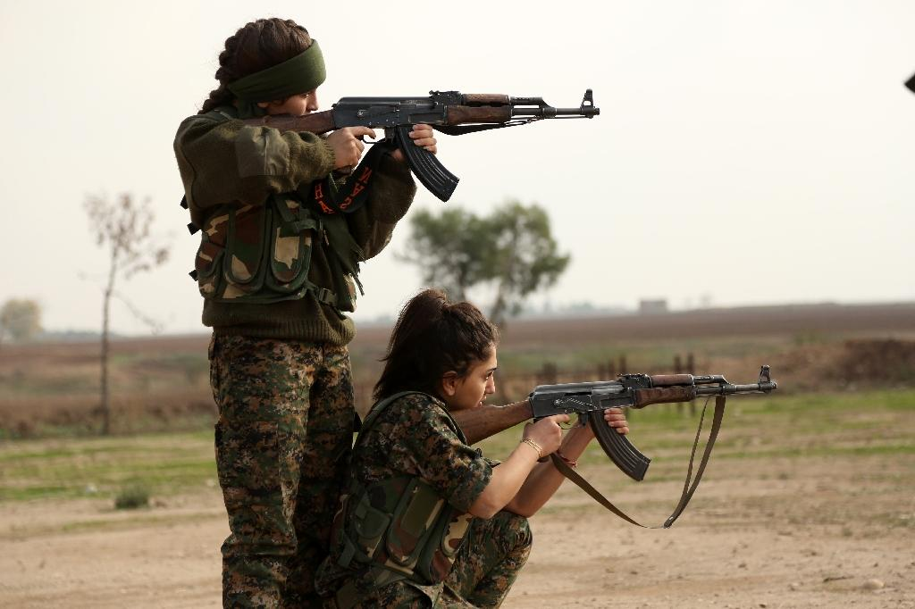 """Syriac Christian women, members of the battalion called the """"Female Protection Forces of the Land Between the Two Rivers"""" train at their camp in the town of al-Qahtaniyah (AFP Photo/Delil Souleiman)"""