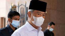Biggest party in Malaysia's ruling alliance backs PM Muhyiddin amid turmoil