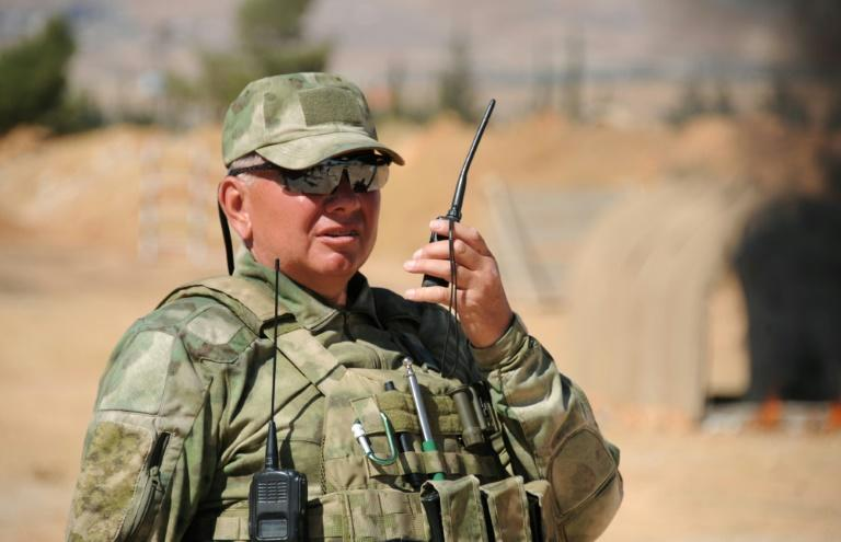 A Russian adviser barks instructions over a walkie-talkie at a military training ground in the countryside outside the Syrian capital Damascus (AFP Photo/Maxime POPOV)
