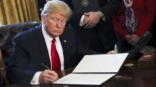 Trump signs executive actions to review tax regulations, roll back Dodd-Frank
