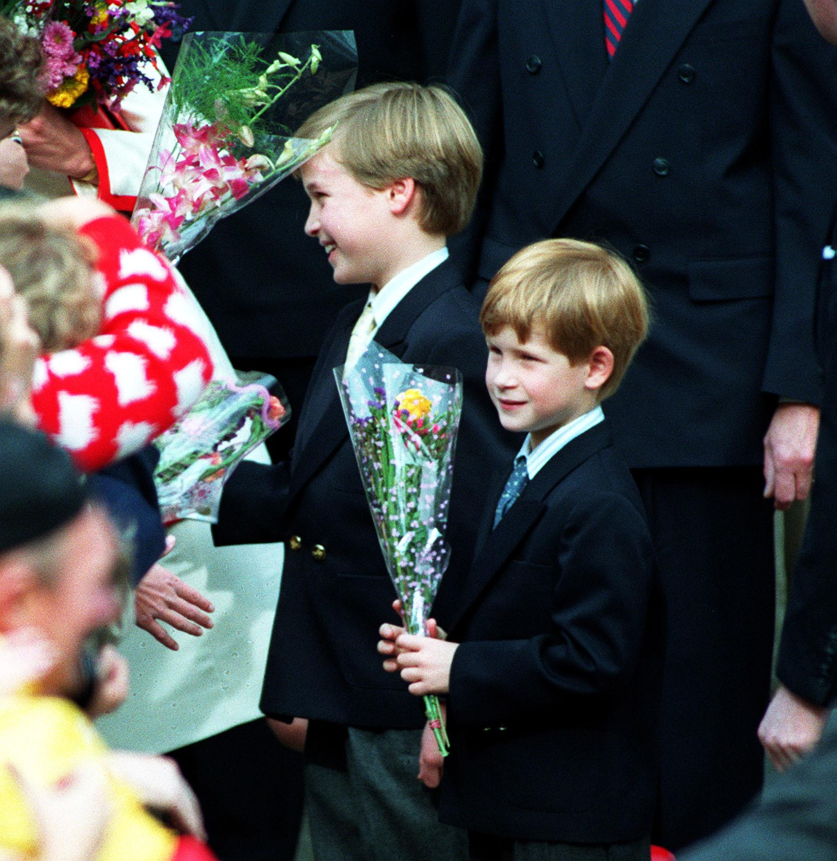 Prince William (left), aged 9, and Prince Harry, aged 7, go for an informal walkabout after they had attended Sunday morning service  with their parents, the Prince and Princess of Wales, at St. James' Cathedral in Toronto, Canada. The family then left Toronto on board the royal yacht.   (Photo by Martin Keene - PA Images/PA Images via Getty Images)