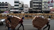 Indonesia Economy Shrinks for First Time Since Asian Crisis