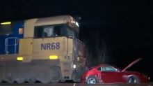 Lucky escape for suspected drunk driver after car gets hit by train