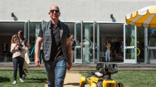 Here's Jeff Bezos taking a robot dog for a walk (AMZN)
