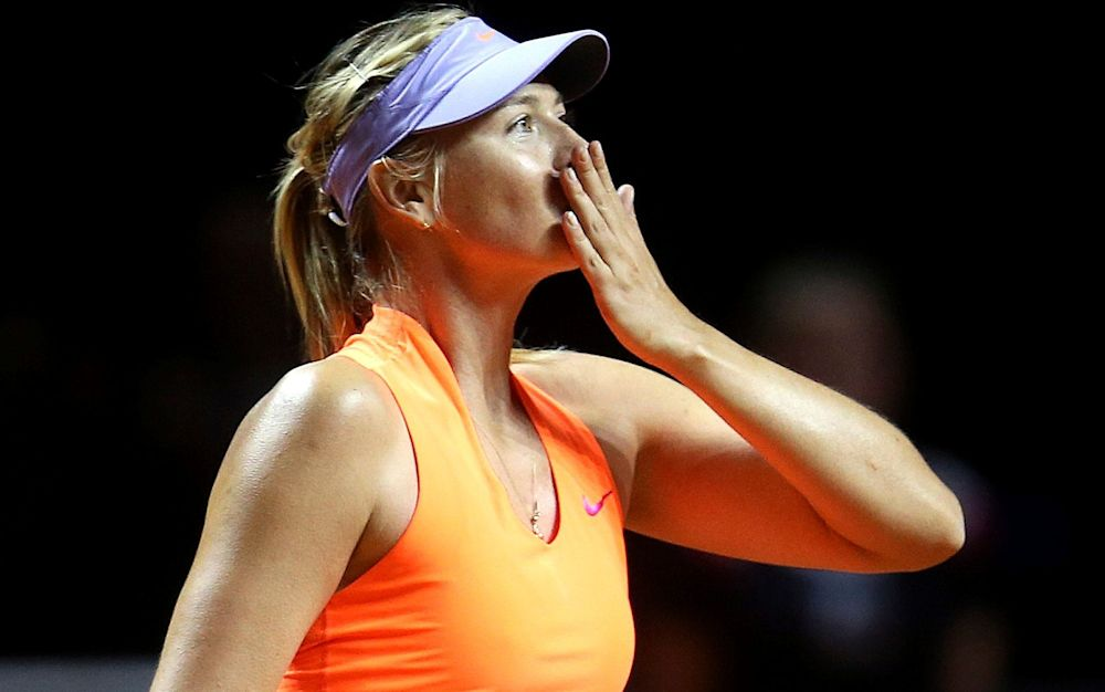 Maria Sharapovablows a kiss after winning 7-5, 6-3 against Italy's Roberta Vinci - AP