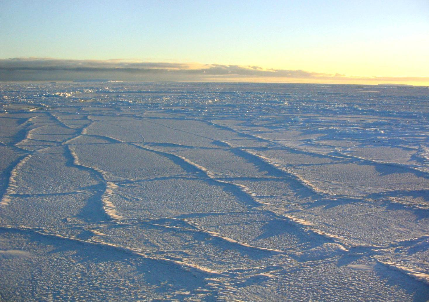 This handout photo provided by NSIDC, University of Colorado, taken in Oct. 2003, shows the Antarctic sunlight illuminating the surface of the sea ice, intensifying the effect of the fracture lines. The ice goes on seemingly forever in a white pancake-flat landscape, stretching so far it just set a record. And yet in this confounding region of the world, that spreading ice may be a cock-eyed signal of man-made climate change, scientists say. (AP Photo/NSIDC, University of Colorado)