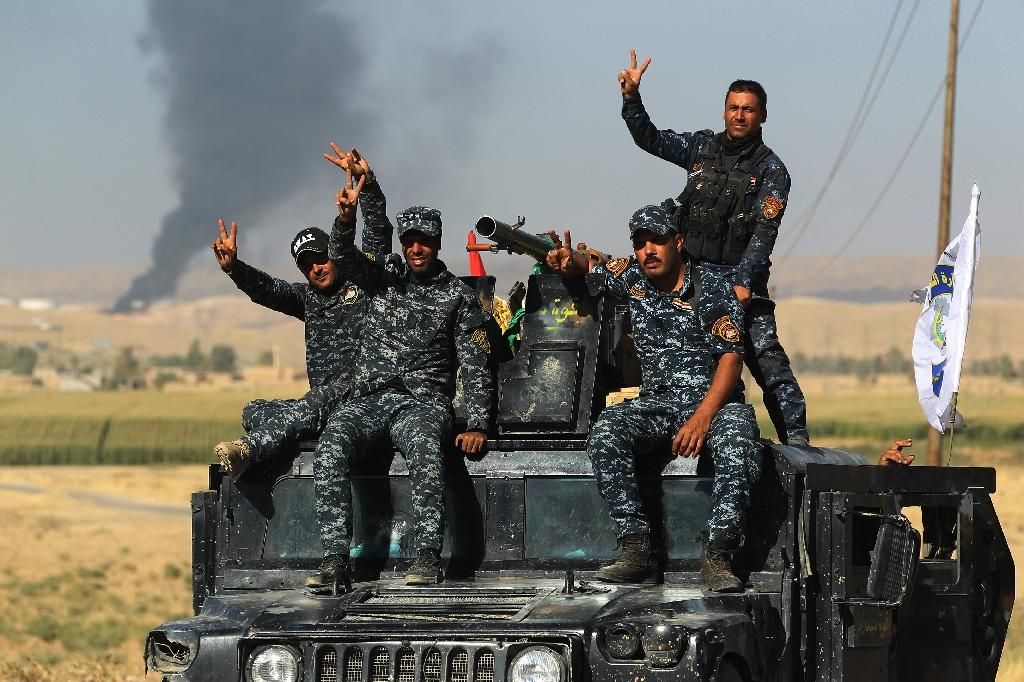 Iraqi government forces equipped with US weapons and vehicles have taken control of the rich oil fields around the Kurdish-claimed city of Kirkuk (AFP Photo/AHMAD AL-RUBAYE)