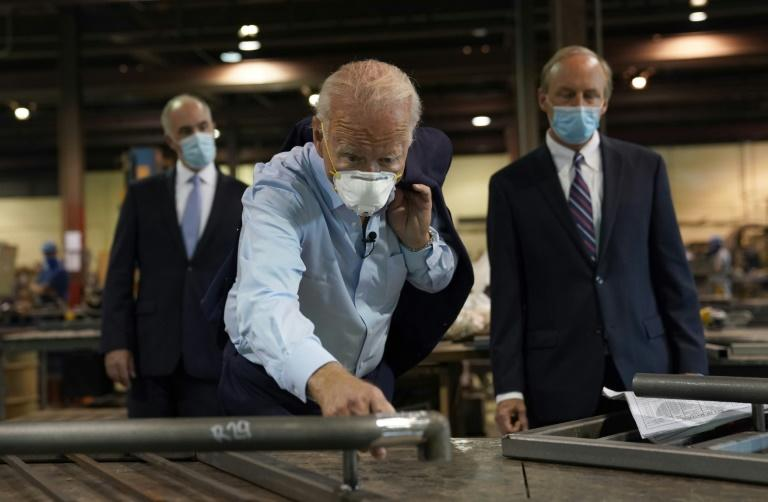 A masked Democratic US presidential candidate Joe Biden toured McGregor Industries in Dunmore, Pennsylvania before unveiling a $700 billion plan to help the battered US economy recover from the coronavirus crisis and adapt to industries of the future (AFP Photo/TIMOTHY A. CLARY)