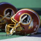 Trump loses battle in 'culture war' as Washington NFL team will drop Redskins name