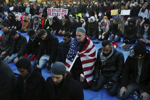 Rutgers University students and supporters gather for Muslim prayer