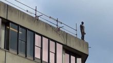 Students tell of shock at Antony Gormley 'suicide' statue on roof