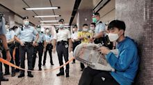 Hong Kong police cordon off passenger for reading pro-democracy newspaper on metro