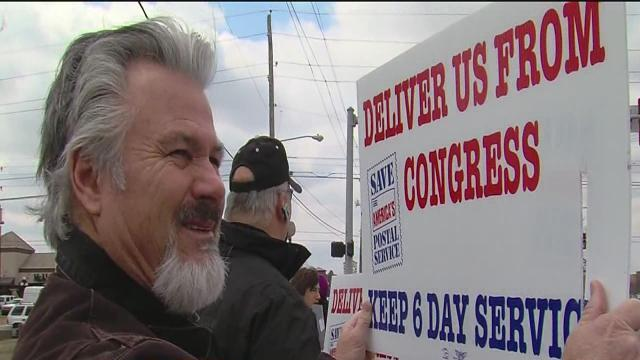 Local postal workers rally to keep sixt-day delivery