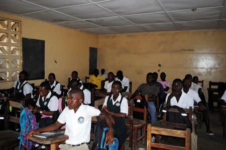 Children sit in class in Monrovia