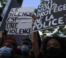Paris: Tear gas fired at protest against police violence