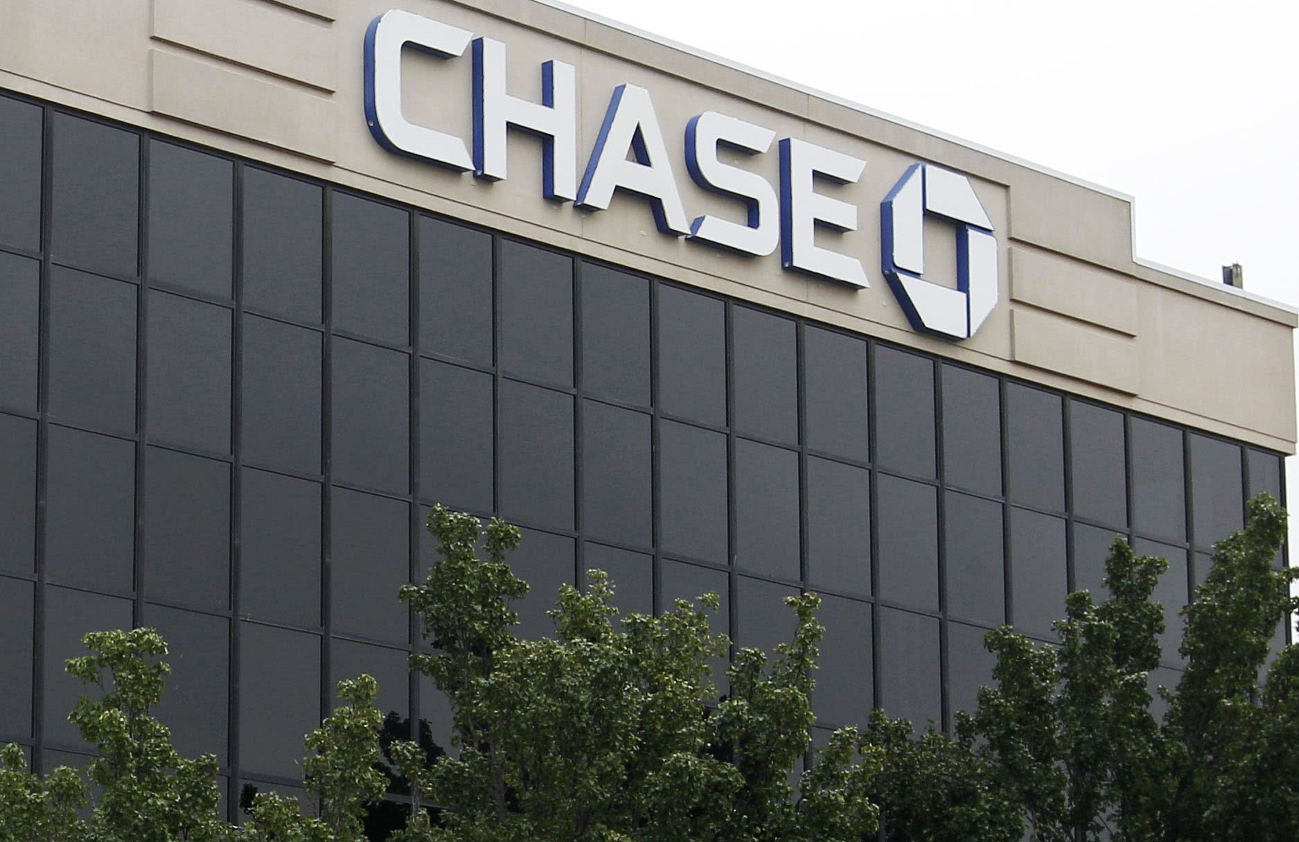 This Thursday, Oct. 11, 2012, photo shows a JPMorgan Chase branch office in Oklahoma City. JPMorgan Chase, the country's biggest bank by assets, reported a record quarterly profit Friday, Oct. 12, 2012. The bank said it made $5.3 billion in earnings for common shareholders, a widely used measurement, from July through September, up 36 percent from the same period a year ago. (AP Photo/Sue Ogrocki)