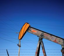 Oil rises to $69 as Mideast tension and supply cuts offset trade concerns