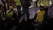 Extinction Rebellion activists dressed as canaries block mine entrance