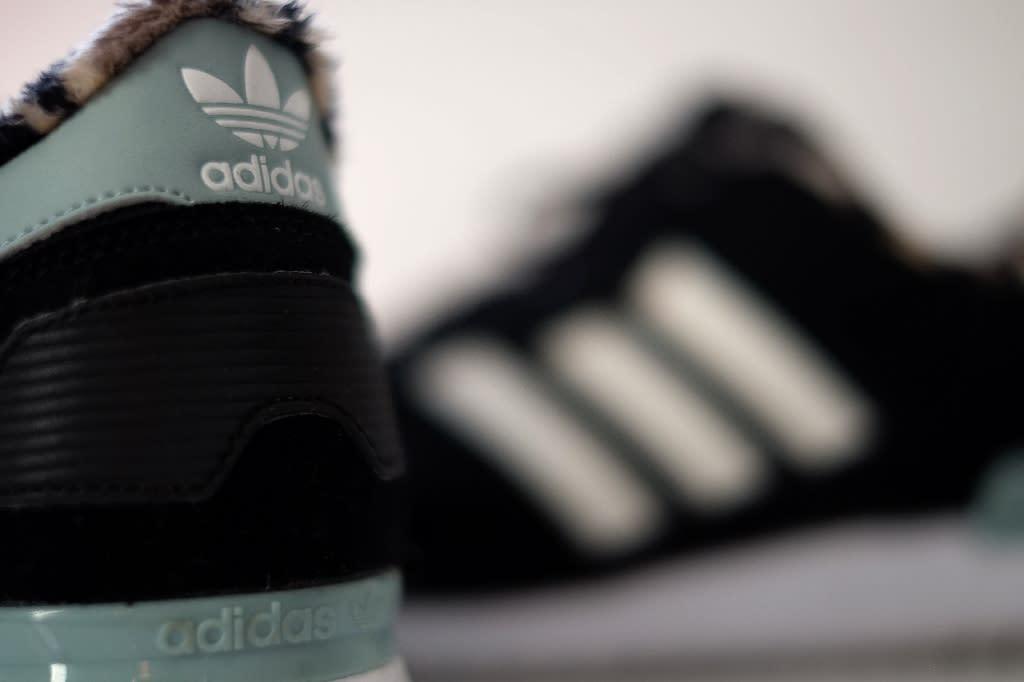 Adidas said last month it would buy back three billion euros worth of stock (AFP Photo/PATRIK STOLLARZ)