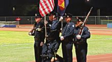 Paralyzed police officer stands for National Anthem in viral photo
