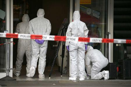 Police investigators work at the crime scene after a knife attack in a supermarket in Hamburg, Germany, July 28, 2017. REUTERS/Morris Mac Matzen