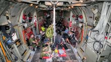 Exhaustion, concern and relief on board first Hercules airlift for Manitoba fire evacuees
