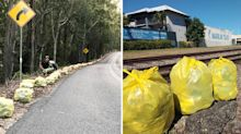 The touching story behind these yellow rubbish bags at the side of the road