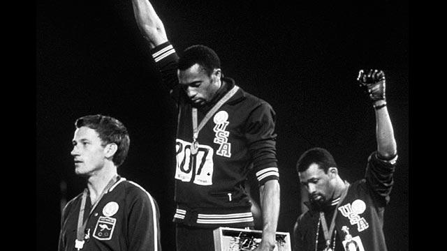 Raised fists on the medal stand, 1968