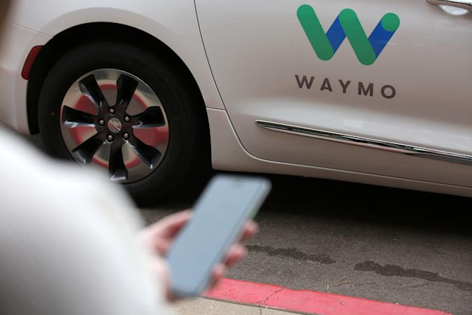 A Waymo employee hails a ride on their phone during a demonstration in Chandler, Arizona, November 29, 2018. Picture taken November 29, 2018. REUTERS/Caitlin O'Hara