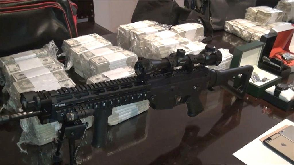 Argentinian police video image shows money, weapons, jewels and other objects seized from former minister Jose Lopez, 55, while trying to hide them at a nunnery (AFP Photo/)