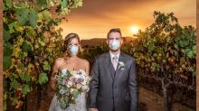 Couple's wedding photo featuring California wildfire receives mixed response