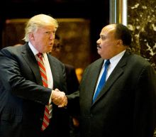 Trump meets King's eldest son on civil rights holiday