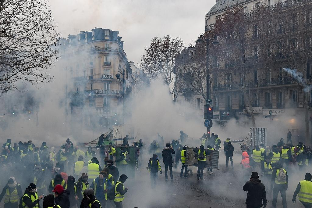 The protests have since morphed into a wider rebuke of French President Emmanuel Macron (AFP Photo/Lucas BARIOULET)