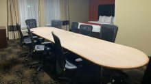 A man who was put up in a Comfort Inn 'boardroom suite' discovered it was literally a boardroom with a bed