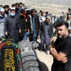 At least 68 killed in Afghan school blast, families bury victims