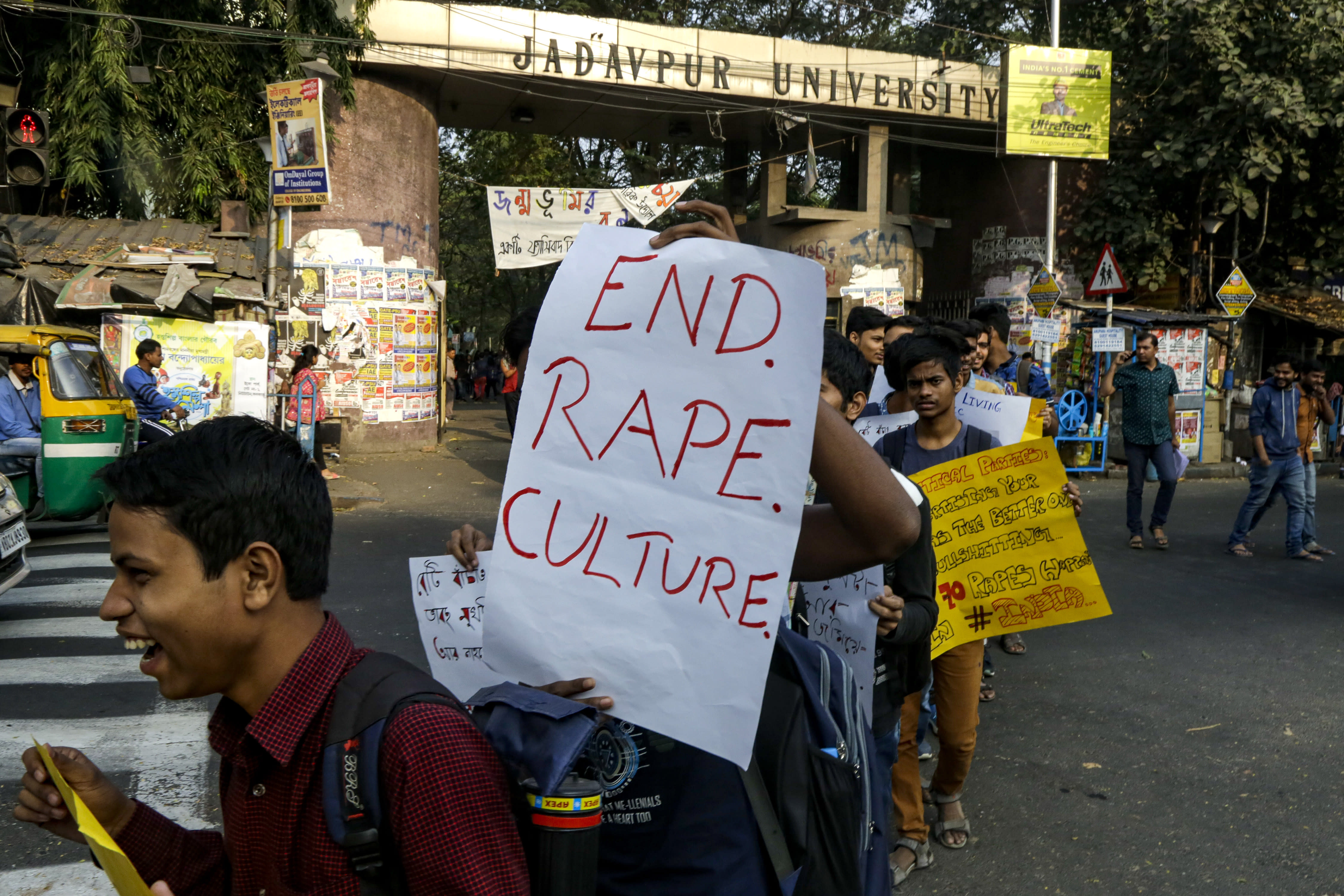 University students shout slogans demanding justice in the case of a veterinarian who was gang-raped and killed last week during a protest rally in Kolkata, India, Monday, Dec. 2, 2019. The burned body of the 27-year-old woman was found Thursday morning by a passer-by in an underpass in the southern city of Hyderabad after she went missing the previous night. (AP Photo/Bikas Das)