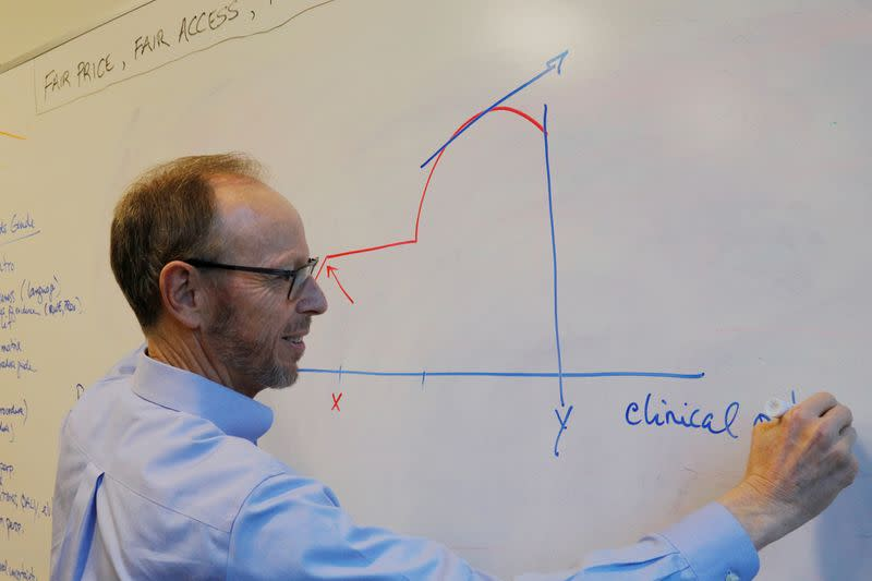 Steven Pearson draws a chart at ICER's offices in Boston