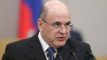 Mikhail who? Weary Russians welcome change of prime minister