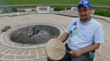 At the heart of Indigenous Day Live, a knowledge keeper stokes the sacred fire