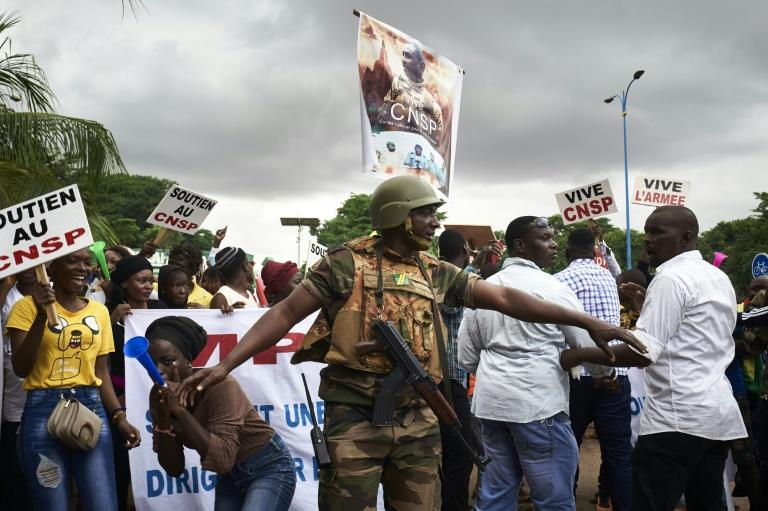 Supporters of the junta celebrate during a demonstration in Bamako at the start of talks